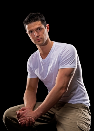 Handsome young man sitting isolated Stock Photo - 16966744