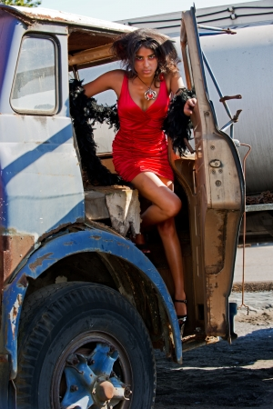Sexy woman getting out of an old semi truck