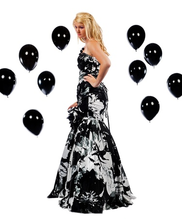 Pretty teen girl in prom dress and surrounded by balloons photo