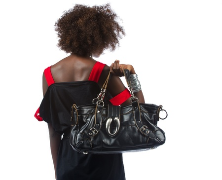 African american woman slinging her bag over her shoulder Stock Photo - 16114364