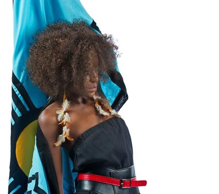 Beautiful black woman reaching up behind her Stock Photo - 16116617
