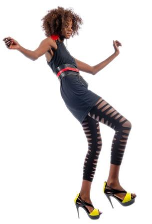 Beautiful black woman dancing showing off her long legs Stock Photo - 16116574