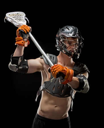 Boys lacrosse player taking a shot