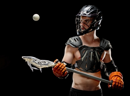 athletic gear: Mens lacrosse player keeping his eye on the ball