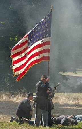 September 22, 2012 NORTHWEST CIVIL WAR COUNCIL Battle Reenactment - McIver State Park Estacada Or   Participants of the union army hold their ground on the battle field as smoke from the gunfire surrounds them and their comrades lay fatally wounded around