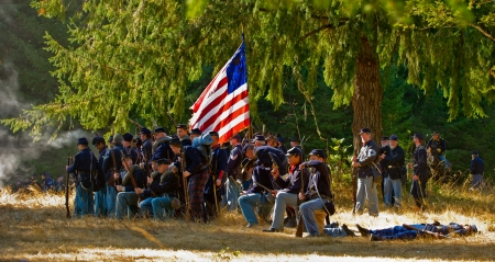 September 22, 2012 NORTHWEST CIVIL WAR COUNCIL Battle Reenactment - McIver State Park Estacada Or   Participants of the reenactment engaged in the afternoon battle as the Union soldiers surround the flag and fire on the rebels and their mortally wounded f