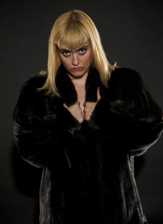 Blonde woman in black fur coat