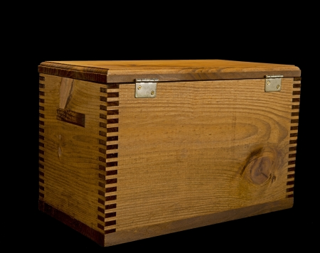 hinged: Wooden box isolated on black