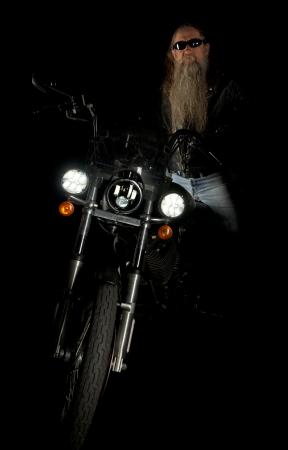 Biker in the dark shadows of the night Stock Photo