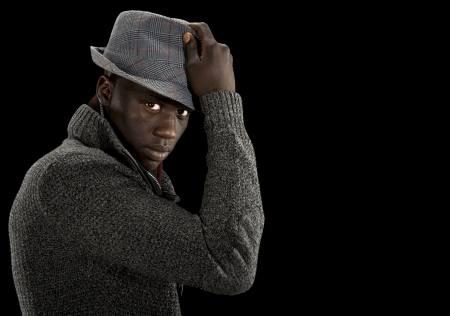 A handsome black male model looks into the camera as he tips his hat  Stock Photo - 16077963