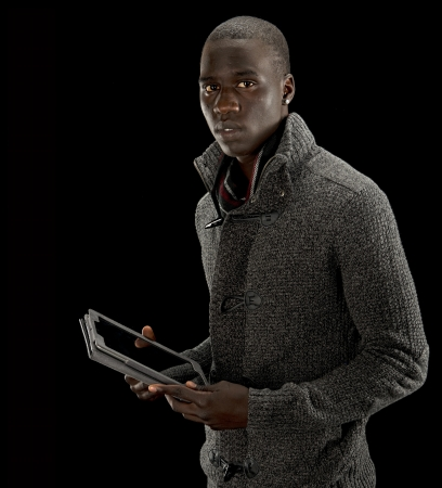 Black man working with a tablet pc  photo
