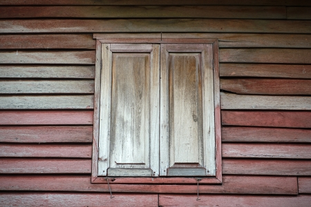 wooden old home wall and windows photo