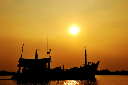 silhouette of fishing boat photo