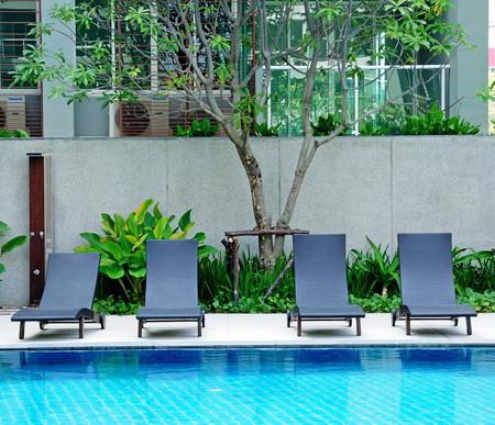Beach chairs side swimming pool in Thai resort photo