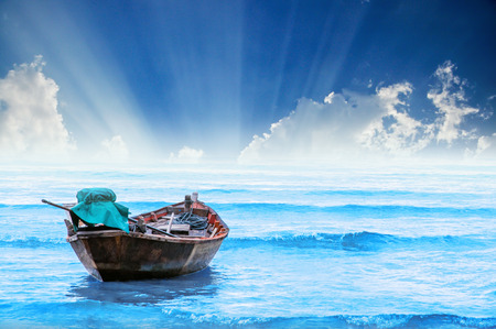 fishing boat on the sea with sunray, Hua-Hin , Thailand photo