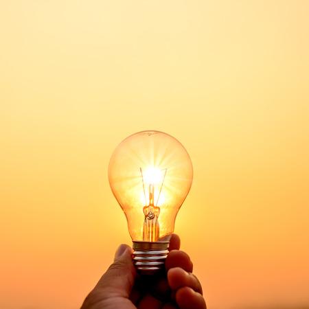 light bulb hold in hand