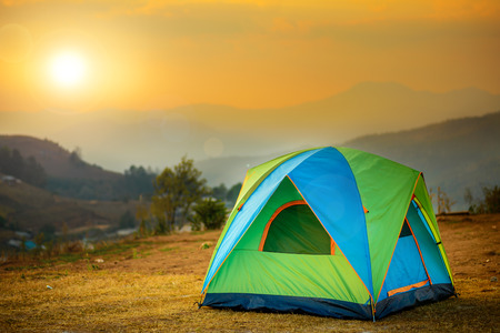 tent in the sunset overlooking mountains and a valley photo