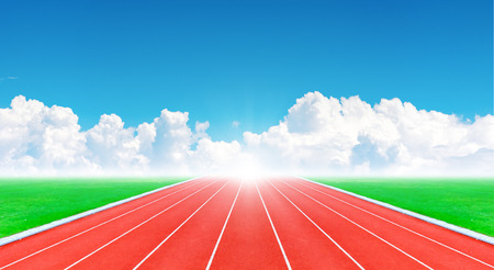 running track in blue sky and clouds photo