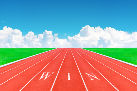 Wording WIN on running track in blue sky and clouds photo