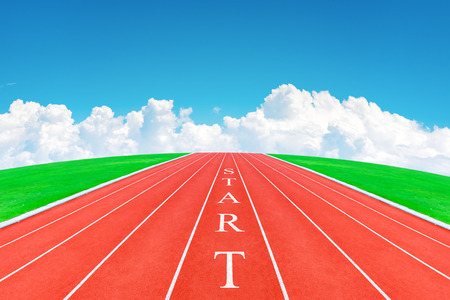 Wording START on running track in blue sky and clouds photo