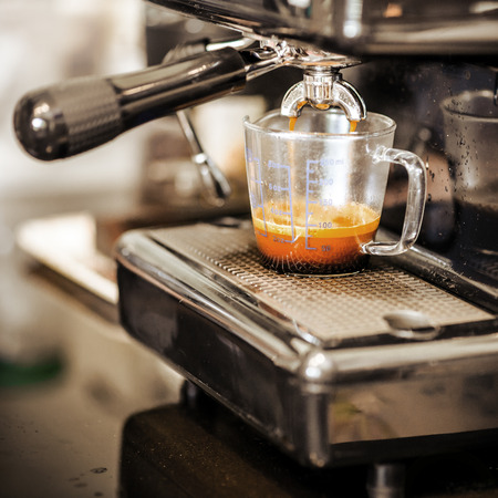 caf: Espresso coffee machine in vintage backgrounds