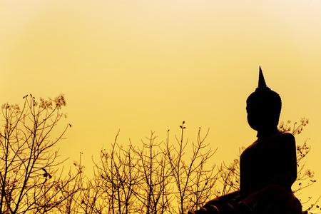 Buddha statue silhouette in sunshine photo