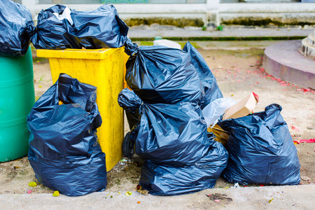 garden waste: Big pile of garbage and waiste in black bags