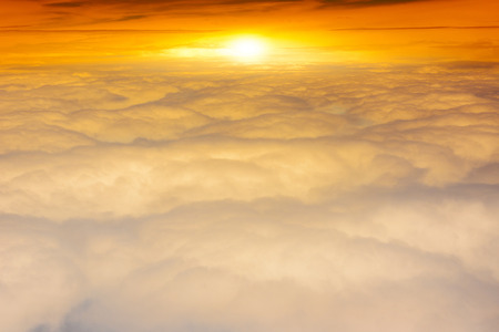above clouds: Beautiful sunrise above clouds during a flight