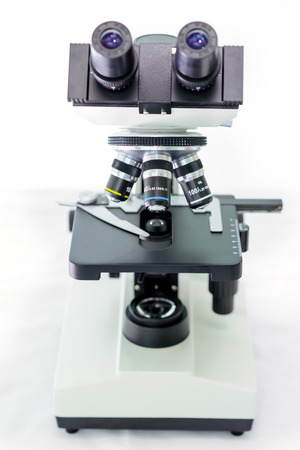 an eyepiece: laboratory microscope with stereo eyepiece isolated on a white background