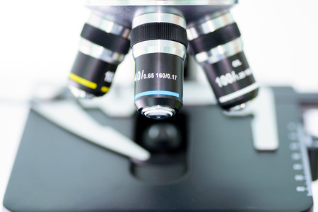 laboratory microscope with stereo eyepiece isolated on a white background