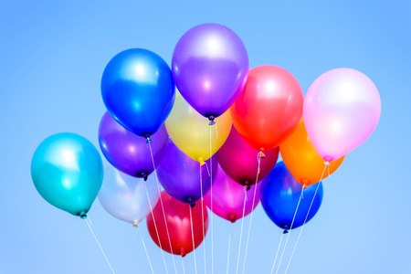 colorful balloons in blue sky and clouds