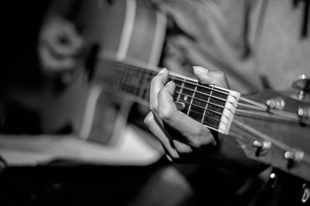 guitar pick: Close-up man playing acoustic guitar Stock Photo