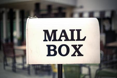 await: White Mail Box , vintage background