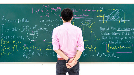 solve problems: man tries to solve problems equation on blackboard Stock Photo
