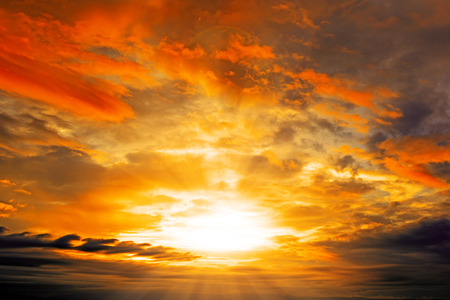 Clouds and Sunset with sun rays Stock Photo