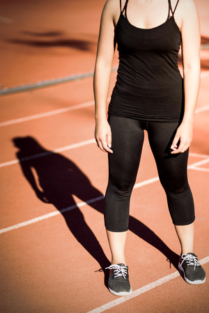 woman shadow: shadow of sport woman on running track Stock Photo