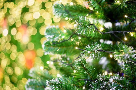 closeup of christmas lights hanging in a christmas tree with bokeh background stock photo 56839212 - How To Put Christmas Lights On Tree