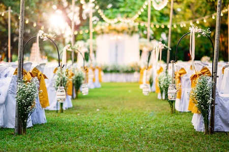 dining set: Beautiful Wedding ceremony in garden at sunset Stock Photo