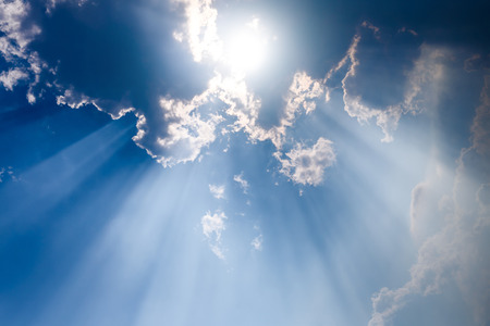 cloudscapes: Sunbeam through the haze on blue sky , clouds with sun rays