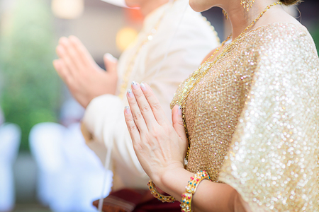 rite: Bride and Groom hands in the wedding ceremony, Wedding Thai ceremony Stock Photo