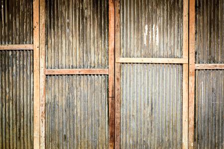 vertica: Door with zinc wall texture background