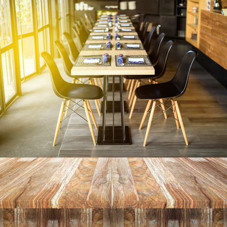 top wooden counter table in Restaurant room with modern wooden furniture background Stock Photo
