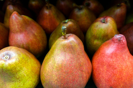 Ripe red pears in basket Stock Photo