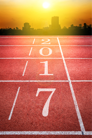 2017 Happy New Year, athletics sport running track concept with cityscape silhouette in sunset
