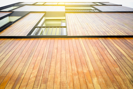 Exterior of a Wooden Building background with warming sunrise