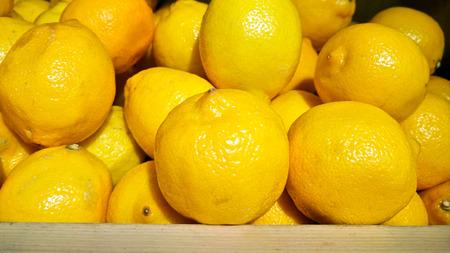 yellow lemon on woonden box sale in fresh market Stock Photo