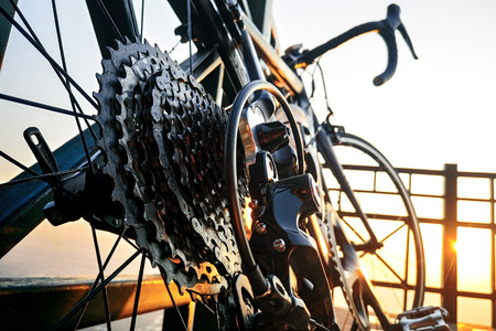 Close up of a Bicycle wheel with gears details in morning sunrise