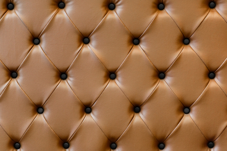 luxury buttoned brown leather background