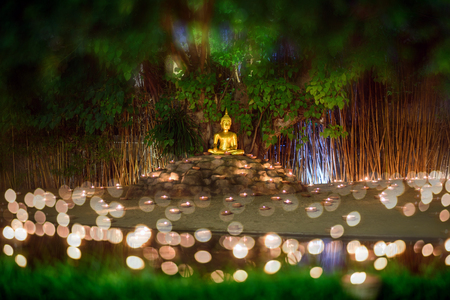 Panorama of Candle Light with Buddha Statue at Wat Pan Tao Temple with beautiful water reflection in Phan Tao Temple, Chiangmai, Thailand