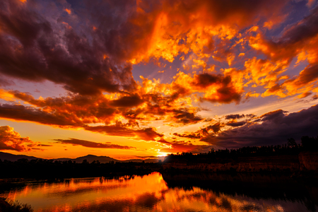 Dramatic Sunset Sky with clouds over the Lake